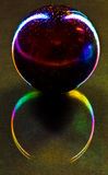 Stone globe and colorful reflection Royalty Free Stock Photos