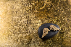 Stone with golden wings for a elegant background. Royalty Free Stock Image