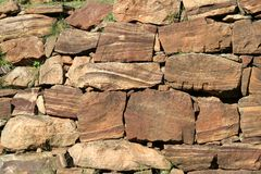 Stone Grain Pattern. Wall built with dressed stones having beautiful grain pattern Royalty Free Stock Image