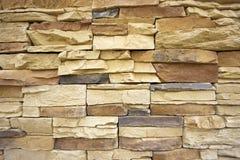 Stone granite natural wall. Stone granite natural sand colored wall Stock Photography