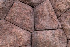 Stone granite red carved uneven large block base mineral terracotta traditional design decoration embankment stock images