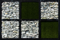 Stone Wall. Stone and grass on the wall Royalty Free Stock Image