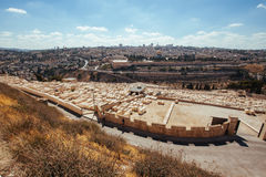 Stone graves and distant city of Jerusalem Royalty Free Stock Images