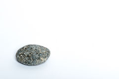 Stone. Gray stone on a white background Stock Image
