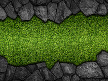 Stone on green artificial turf pattern stock photo