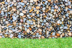Stone and green grass Stock Photography