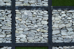 The stone and green grass. On the wall Royalty Free Stock Photo