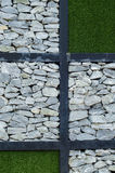 The stone and green grass. On the wall Stock Photography