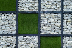 The stone and green grass. On the wall Stock Images