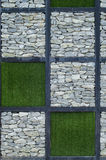The stone and green grass. On the wall Royalty Free Stock Image