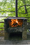 Stone Grill with fire and flame Royalty Free Stock Photo