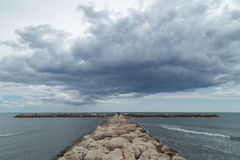 Stone Groyne Pier at Camargue with Dramatic Clouds above Sea Stock Photos