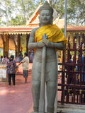 Stone guard at Cambodian shrine Royalty Free Stock Images