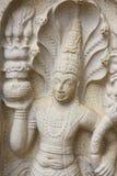 Stone Guardian at Bodhi Temple, Sri Lanka. Image of a stone guardian near the sacred Bo tree at the ancient Bodhi Temple, Anuradhapura at Polonnaruwa, Sri Lanka Royalty Free Stock Photography
