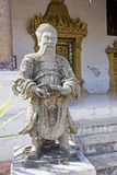 Stone Guardian at buddist temple in Luang Prabang Royalty Free Stock Photos
