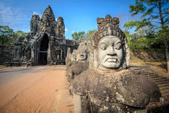 Stone guardians on a bridge at the entrance to a temple in siem reap,cambodia 2 Royalty Free Stock Images