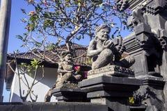Stone guards of the house, Nusa Penida, Indonesia Stock Photo