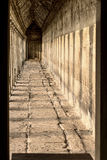 A stone hall in a temple with sun rays Stock Photos