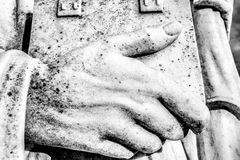Stone Hand with Book Royalty Free Stock Images