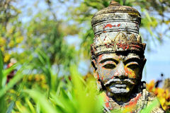 Stone Head. Balinese people believe in Hinduism. The Hindu statues are found everywhere in Bali Stock Image