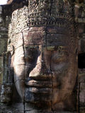 Stone head, Bayon temple, Cambodia. Huge stone face from the Bayon temple, Angkor wat complex, Cambodia Royalty Free Stock Images