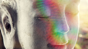 Stone head of buddha in the ray of light Royalty Free Stock Image
