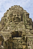 Stone head of buddhas on towers of Bayon temple. Stone head on towers of Bayon temple in Angkor Thom, Cambodia Royalty Free Stock Photo