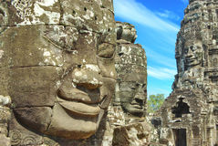 Stone Head On Towers Of Bayon Temple Stock Images