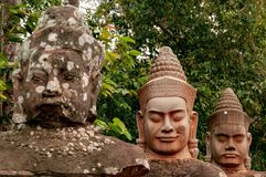 Stone Head Statues in Angkor Wat, Siem Reap, Cambodia, Indochina, Asia - face on in colour. Newer and older stone heads in Angkor Wat, Cambodia, Indochina. The stock photo