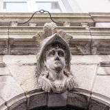 Stone head on a stone arch Royalty Free Stock Photography