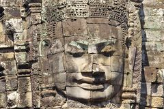 Stone head on towers of Bayon Stock Photos