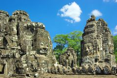 Stone head on towers of Bayon temple. Royalty Free Stock Photos
