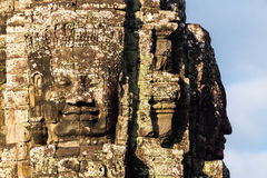 Stone head on towers of Bayon temple Royalty Free Stock Image