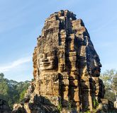 Stone head on towers of Bayon temple Royalty Free Stock Images