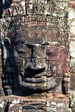 Stone head on towers of Bayon temple Royalty Free Stock Photo