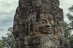 Stone head on towers of Bayon temple in Angkor Thom, Cambodia Royalty Free Stock Photo