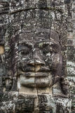 Stone head on towers of Bayon temple in Angkor Thom, Cambodia. S Stock Photo