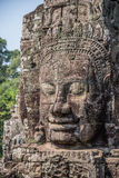 Stone head on towers of Bayon temple in Angkor Thom, Cambodia. S Royalty Free Stock Images