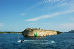 Stone headland in Croatia with jetski Stock Image