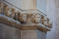 Stone heads at Cathedral of St. James in Sibenik, Croatia Stock Photos