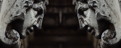 Stone heads. Stone head from tenement house in Cracow Royalty Free Stock Image