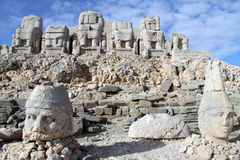 Heads and headless. Stone heads and headless statues on the top of mount Nemrud, Turkey Royalty Free Stock Photo