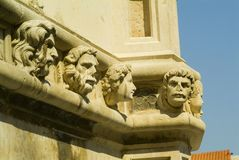 Stone heads - Sibenik cathedral Stock Photos