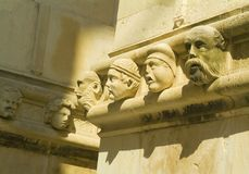 Stone heads of townspeople - Sibenik cathedral Stock Photo
