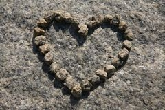 Stone heart. Laid out from small pebbles on the big stone Royalty Free Stock Image