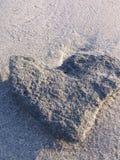Stone heart. An image of an heart-shaped stone, Porto Pino Stock Image