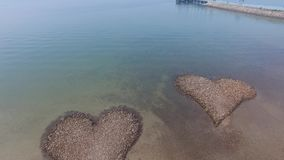 Stone heart on the beach stock footage