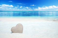 Stone heart on the beach Royalty Free Stock Images