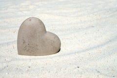 Stone heart on the beach. Large stone heart on the sandy beach Royalty Free Stock Photo