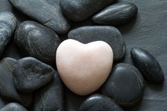 Stone heart and other stones abstract background Royalty Free Stock Photos